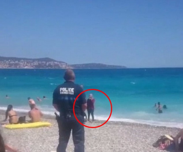 Video has emerged of armed police waiting for Muslim women to come out of the sea at nearby Nice, and then warning them about their choice of headscarves