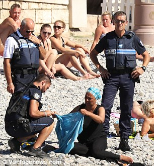 Police officers stand over the woman in Nice