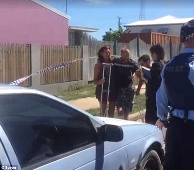A woman is dead and a man has been left fighting for his life after they were stabbed at a backpackers hostel in north Queensland