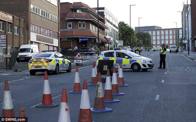 Police sealed off the road in Birmingham (pictured) after making an arrest on Friday