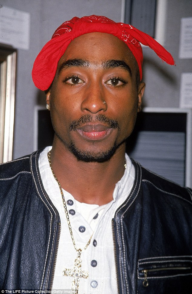 The video claims the 'selfie' of Tupac was taken on an iPhone, and compares the person in it to the rapper (pictured)