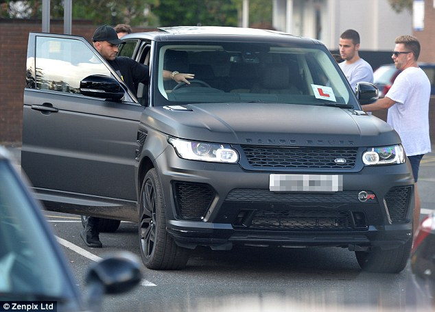 Luke Shaw takes his matte Range Rover out for a spin as he carries on learning how to drive