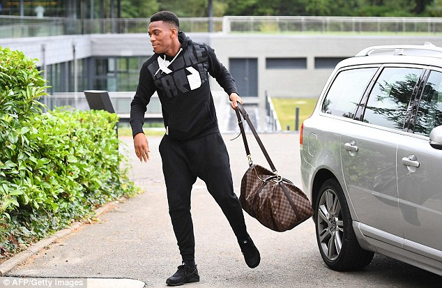 Anthony Martial was seen wearing a Nike Fresh tracksuit (£85) and holding a Louis Vuitton bag