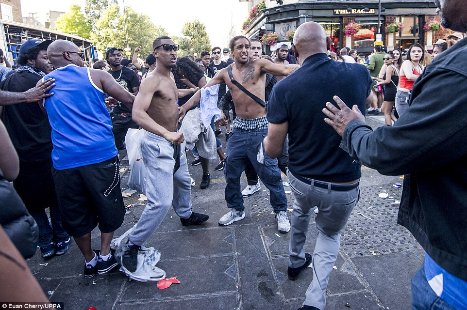 The atmosphere became heated when men argued before a fight broke out yesterday evening during the carnival in London