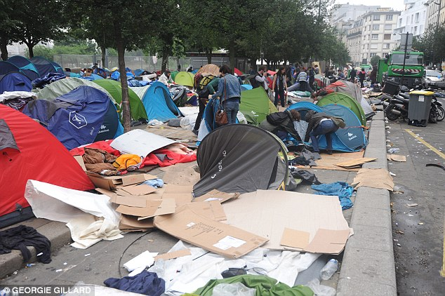 Migrants have contentiously set up their own camps (pictured) in Paris near the Gare du Nord station. Now they will be given two official migrant camps