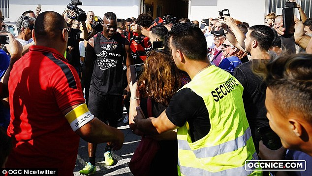Fans and photographers swarmed round Balotelli, who seemingly enjoyed the attention
