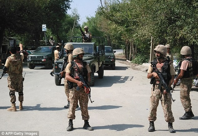 Four suicide bombers who tried to attack a Christian colony in Pakistan have been killed in a brutal gunfight with security forces. Pakistani soldiers cordon off a street leading to the colony