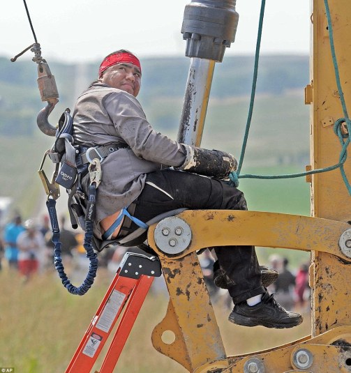 One man protested by attaching himself to heavy equipment at the site of construction of the Dakota Access Pipeline