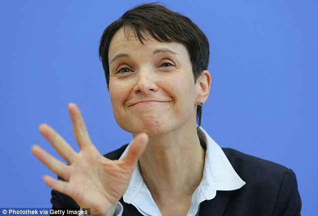 The chancellor is braced for a beating at the hustings on Sunday when the anti-immigration Alternative for Germany (AfD) party is set to defeat her own CDU conservatives in a regional election. Pictured is AfD party leader Frauke Petry