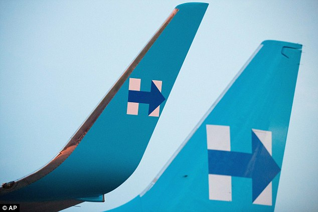 Clinton's signature 'H' - for Hillary - is on the tail