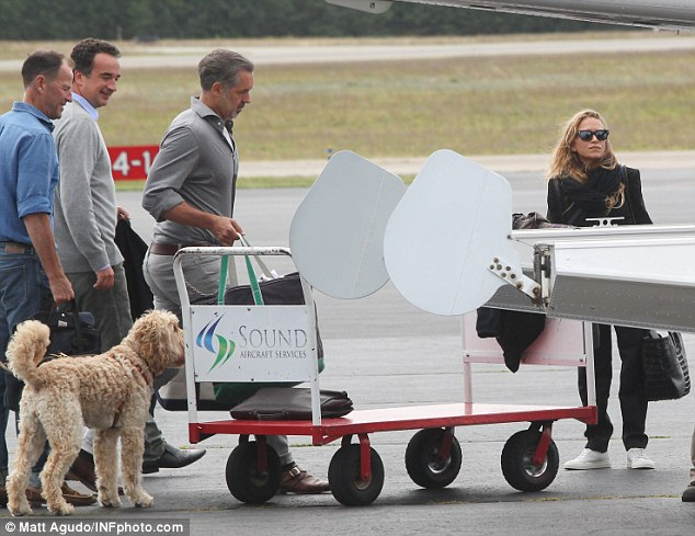 Jet set: The couple had a few bags with them and had some assistance in loading their luggage onto the small plane