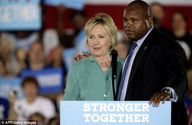 Clinton and the Secret Service are pictured above during a disturbance in the crowd at an August 4 rally at the International Brotherhood of Electrical Workers (IBEW) in Las Vegas, Nevada