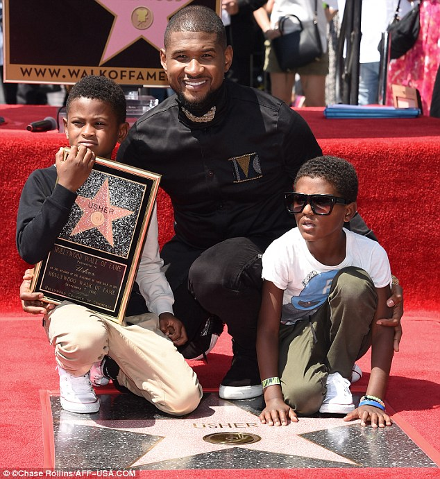 Devoted: The 37-year-old arrived at the ceremony with his sons Usher Raymond V, eight, and Naviyd Ely Raymond, seven; the star was previously married to their mother, Tameka Foster