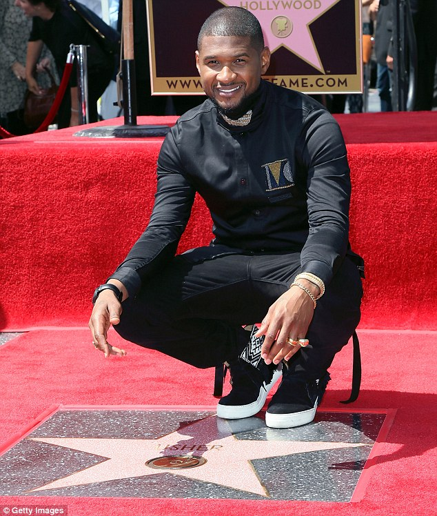 Memorable moment: Usher was honored with a star on the Hollywood Walk Of Fame on Wednesday in Los Angeles