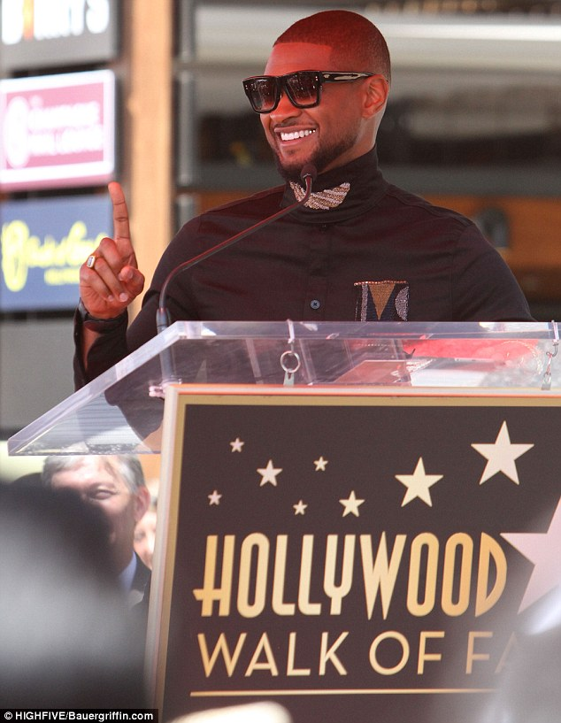 Having a blast: The star grinned ear to ear as he took the stage; he looked dapper in sunglasses