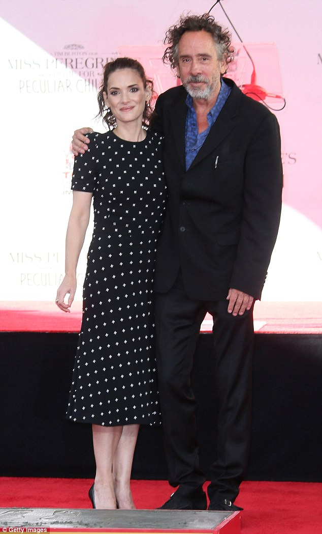 Honored: Winona Ryder joined Tim Burton as he placed his hand and foot prints in cement in front of Hollywood's Chinese Theatre on Thursday