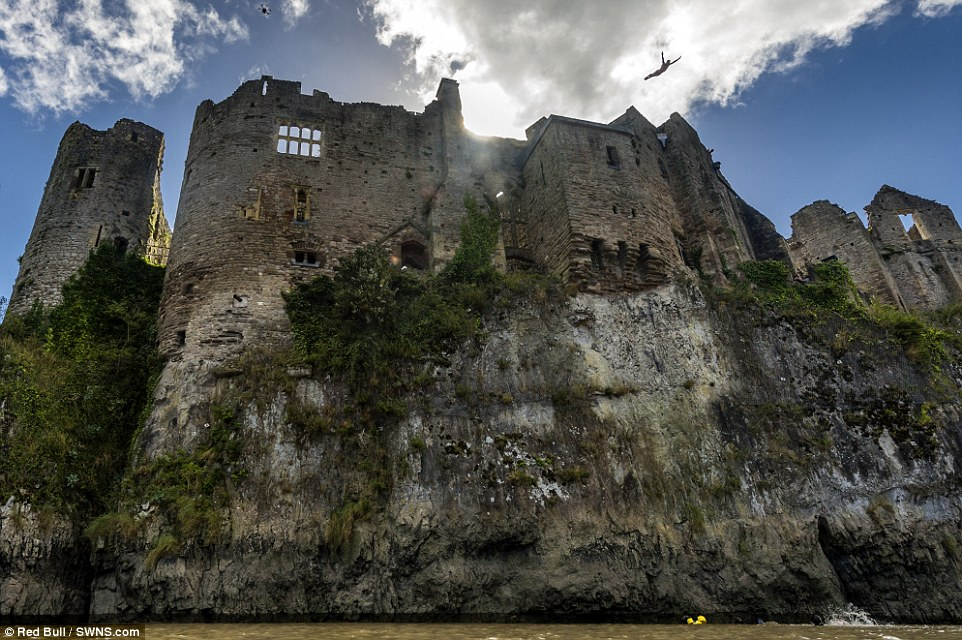 Awesome sight: Blake Aldridge, 34, leapt from the 11th century castle wall into the River Wye which is 85ft down