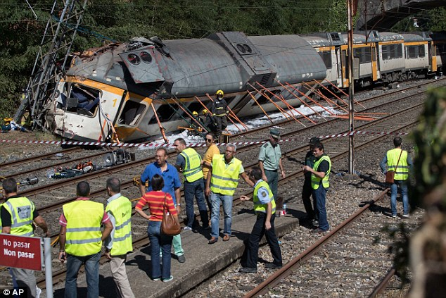 In a statement, Spain's railway company Renfe said the train and the driver were both Portuguese, adding that railway traffic had been suspended in the area