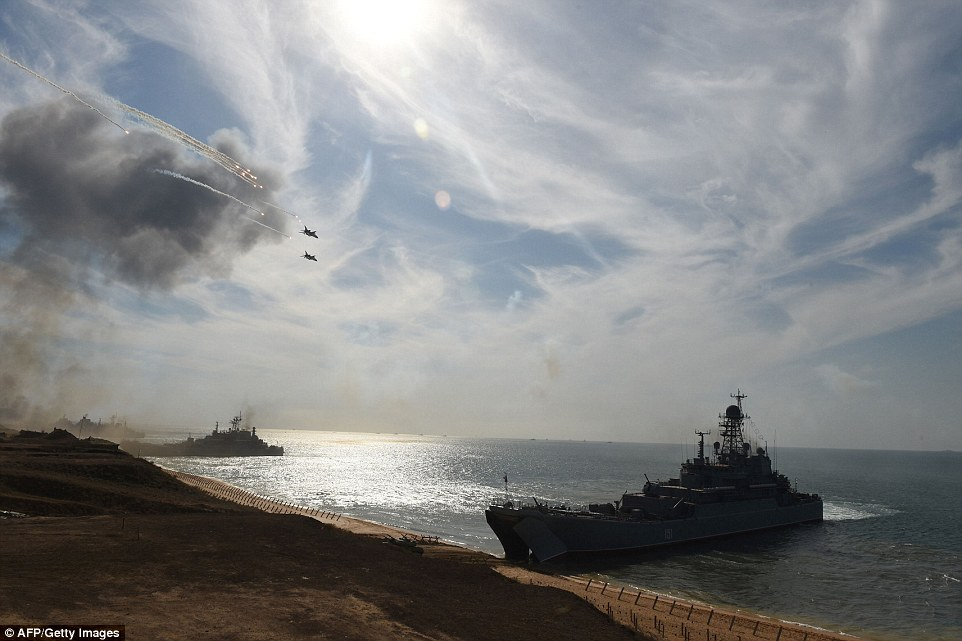 'On such a scale and with the deployment of different force groupings, such drills are being held for the first time,' defence ministry spokesman Igor Konashenkov said. Pictured are warships moored on the Black Sea coast