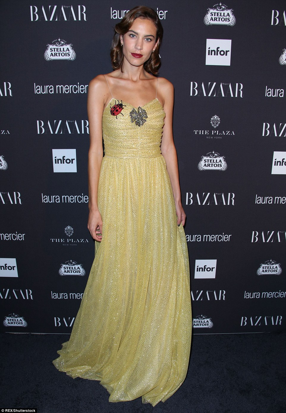 Lovely in yellow: Alexa Chung  chose a brilliant shade of yellow for the evening out