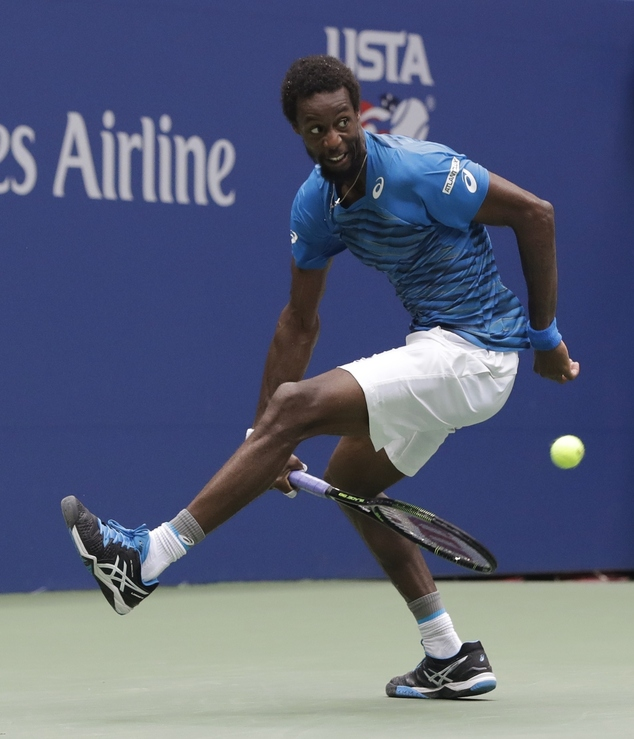 The defiant Gaël Monfils pings the ball back during the match against Novak Djokovic
