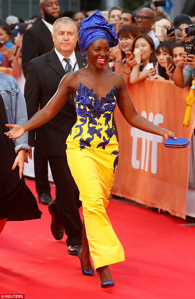 Royalty: The 33-year-old actress wowed in a bright yellow, strapless form fitting gown, which she added pops of royal blue to her shoes, jewelry and headwrap