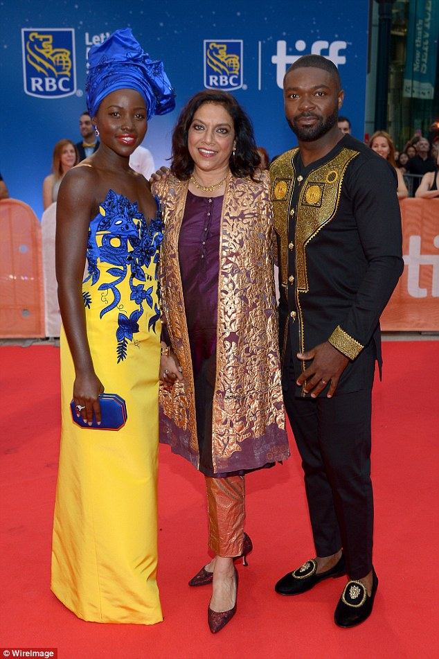 Powerful: Lupita and David joined their director Mira Nair who stunned in an intricate, purple and gold outfit