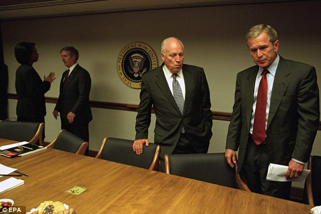 Then-president George W. Bush (far right), his vice president, Cheney, White House chief of staff Andrew Card, and National Security Adviser Condoleezza Rice confer on 9/11