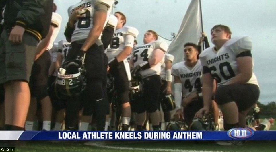 Image result for imAGE, PHOTO, HIGH SCHOOL FANS KNEELING FOR NATIONAL ANTHEM