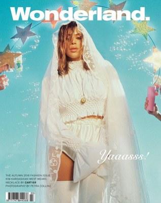 'Yaaasss!' Kim Kardashian is one naughty bride in fishnet stockings as she covers Wonderland magazine