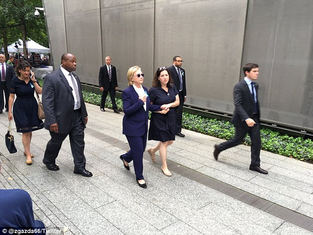 Led away: Clinton aide Christine Falvo, a long-term volunteer and former State Department staffer, escorted the stricken Democratic candidate from the 9/11 memorial