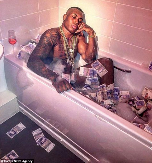 Levis Watson was questioned by police and claimed to have no income – instead living a quiet life in the West Midlands city - but his Instagram pictures showed his lavish lifestyle including this bragging picture which sees him sat unclad in the bath surrounded by dozens of £20 notes