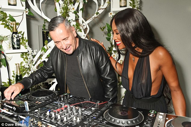 Superstar DJ: Naomi headed behind the decks with DJ Fat Tony and helped her pal spin some tunes