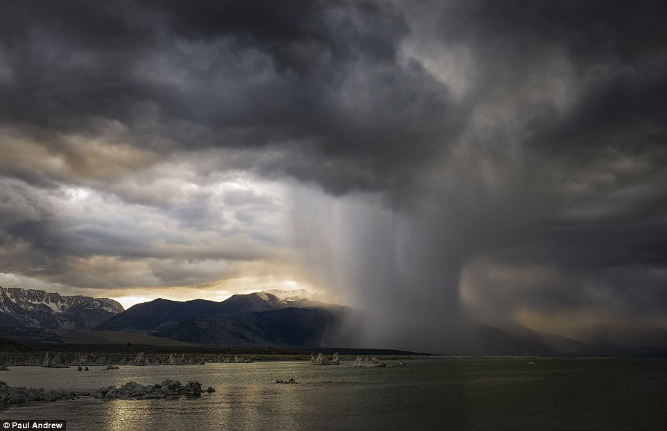 Nick of time: Paul Andrew, who took this dramatic photo at California's Mono Lake, said 'over the space of about 90 minutes I photographed the unfolding scene, only just making it back to the safety of the car as the heavens opened'