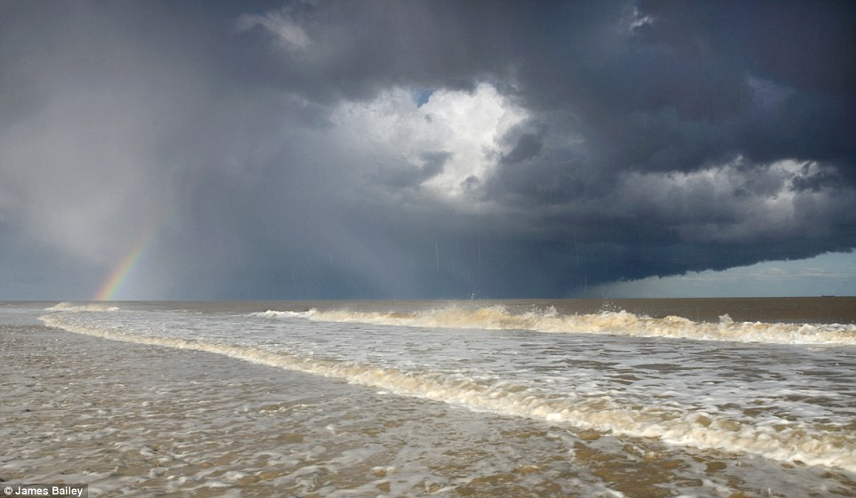 Froth: In the under 16s, James Bailey scooped the top prize for his image Hailstorm and Rainbow over the Seas of Covehithe