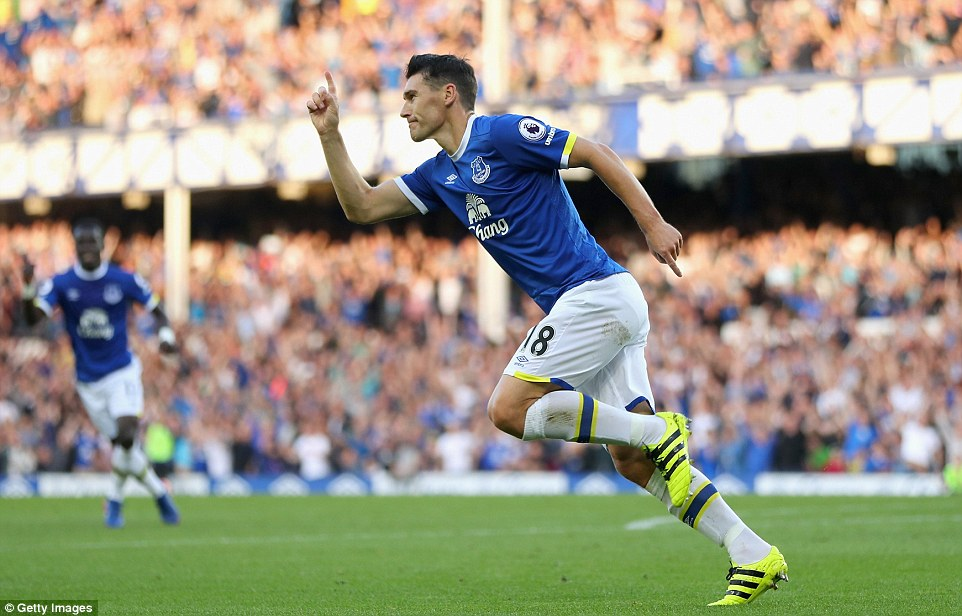 Gareth Barry celebrates after drawing Everton level on his 600th appearance in the Premier League