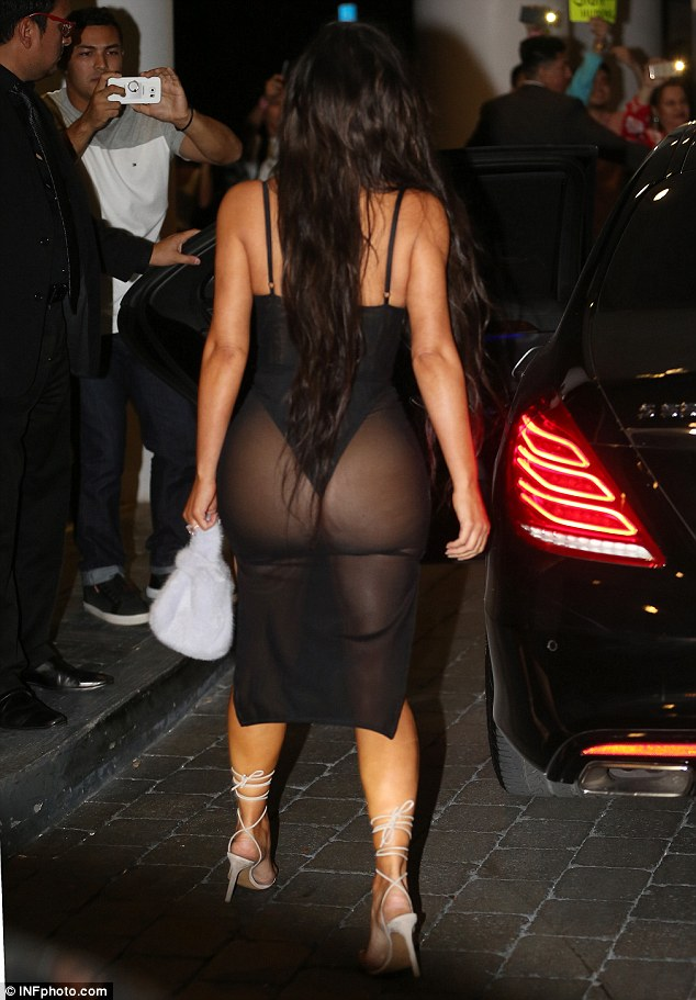Peek-a-boo: She had no problem putting her famous assets on display