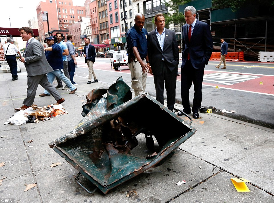 Surveillance footage reportedly shows the same man dropping the pressure cooker bomb off in Chelsea, and another one a few blocks away that never exploded. Above, New York City Mayor Bill de Blasio (right) and New York Gov. Andrew Cuomo (second right) survey the scene on Sunday