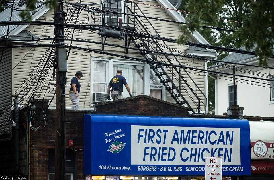 Public records show that Rahami lived at the address with several members of his family. Above, FBI agents search the home and family business on Monday