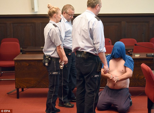 Hassan Z, pictured, knelt on the floor with his shirt over his head at one point as a protest on the first day of his trial