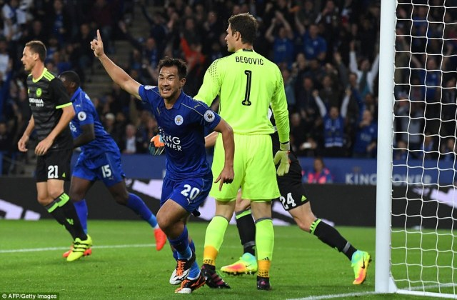 Leicester City's Japanese striker Okazaki celebrates with team-mates after scoring the opening goal at the King Power