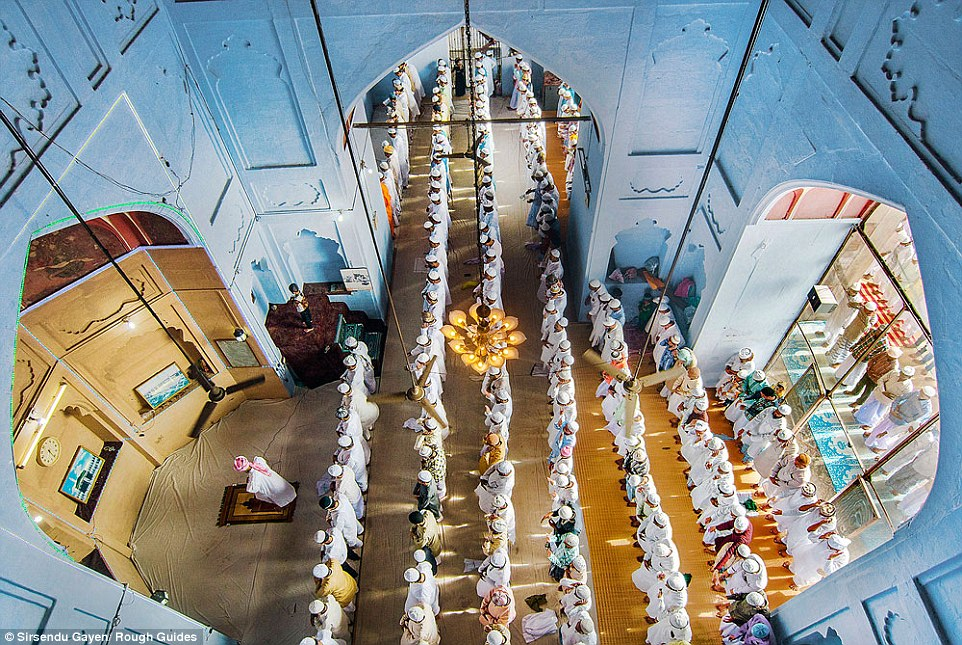 Runner up: Worshippers form orderly lines in this striking aerial taken in a mosque in Varanasi, Uttarpradesh, India. This is a general view of Eid ul Fitr prayer and shows the Hindu–Muslim brotherhood in the region