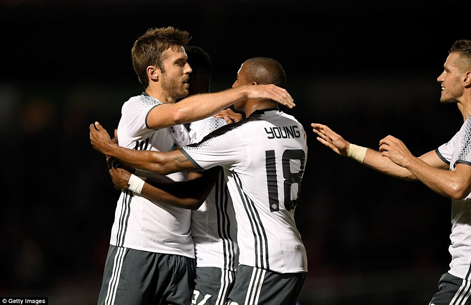 Ashley Young is among the Manchester United players to celebrate with Carrick, who scored in the 17th minute