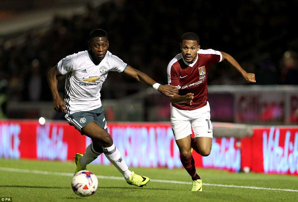 Tim Fosu-Mensah (left) chases down his opponent on a rare appearance for Manchester United's first team