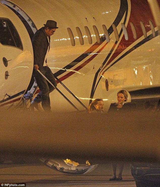 Incident: Pitt is pictured climbing off a jet in 2014 with daughter Vivienne