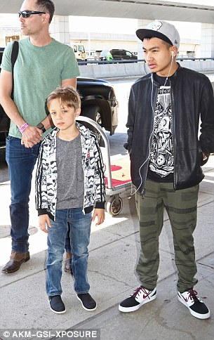 Knox andMaddox are pictured with Jolie's brotherproducer and actor James Haven