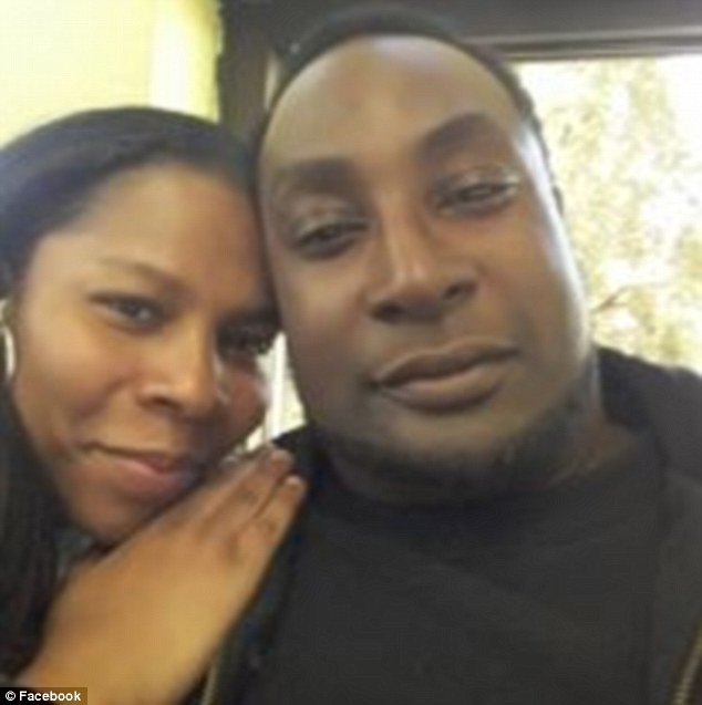 Differing stories: The family of Keith Lamont Scott (pictured with his wife Rakeyia) will be shown the video of his final moments; they insist he was carrying a book, not a gun