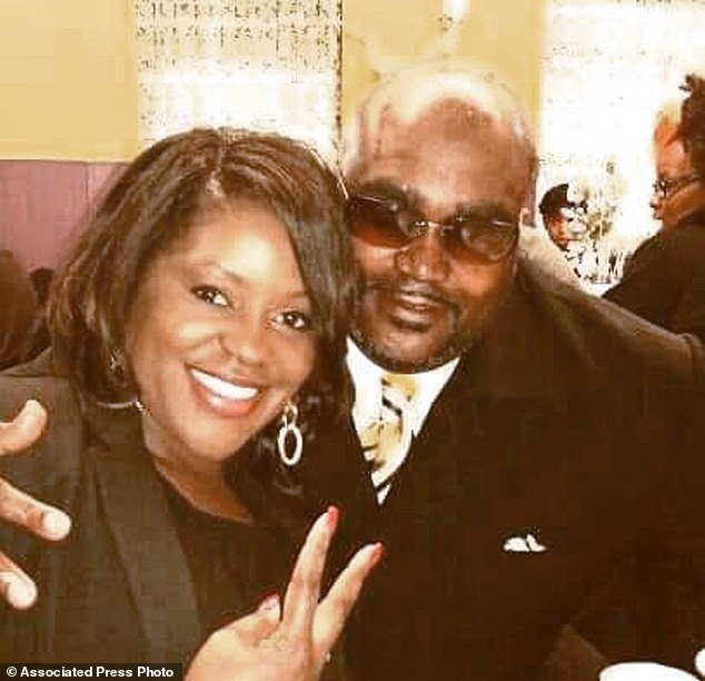 Crutcher, 40, pictured with his twin sister, Tiffany, was shot dead while his arms were in the air