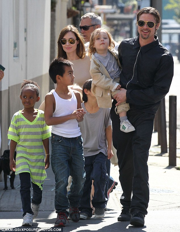 Distraught: Brad Pitt is 'terrified' of losing access to his children with Angelina Jolie amid allegations of abuse. The estranged couple are pictured in 2011 with four of their six children