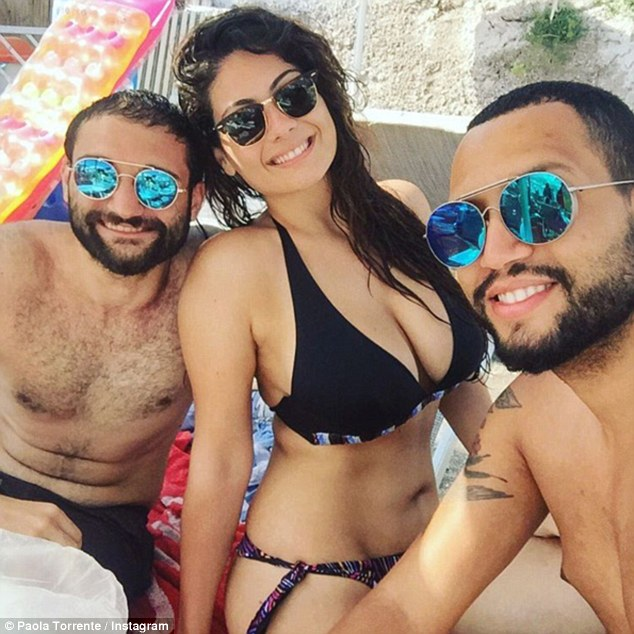 Torrente says she was overwhelmed the love and support she received, but her biggest fan remains her boyfriend Gabriel, who she has been with for four years (pictured: Paola, her boyfriend Gabriel and a friend at the beach)